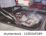 grilling delicious seafood at... | Shutterstock . vector #1100269289