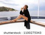 summer lifestyle portrait of... | Shutterstock . vector #1100275343