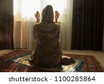 muslim woman praying for allah... | Shutterstock . vector #1100285864