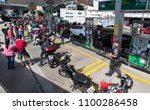 Small photo of RIO DE JANEIRO, Brazil May, 27th, 2018 Drivers truck strike An anti- riot police agent guards a gas station as Rio's resident motorbikers stay on line to fuel due the gasoline shortage