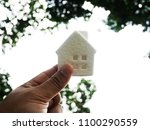 beautiful holding house model... | Shutterstock . vector #1100290559