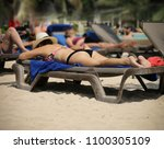 woman on a beach. | Shutterstock . vector #1100305109