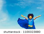 strong girl in blue superhero... | Shutterstock . vector #1100323880