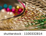 Small photo of Golden hued macro abstract of textured glass reflecting defocused light on diamond cut facets