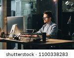 young tired office worker in... | Shutterstock . vector #1100338283