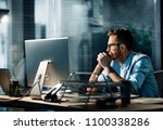 formal man sitting at desk in... | Shutterstock . vector #1100338286