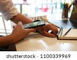 cropped shot of an... | Shutterstock . vector #1100339969