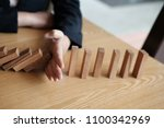 hand stopping effect of domino... | Shutterstock . vector #1100342969