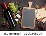 wine  cheese  grape and nuts.... | Shutterstock . vector #1100345309