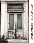 Small photo of Old Deteriorated Doors of a Townhouse
