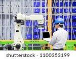 the programmer engineer control ... | Shutterstock . vector #1100353199