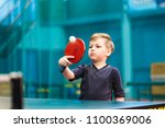 boy in gray t shirt playing... | Shutterstock . vector #1100369006