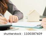 house buyer signs paper... | Shutterstock . vector #1100387609
