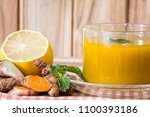 a cup of turmeric tea with... | Shutterstock . vector #1100393186
