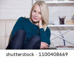 attractive middle aged woman... | Shutterstock . vector #1100408669