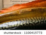 smoked fish on the wooden table ... | Shutterstock . vector #1100415773