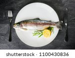 fresh fish on white plate with... | Shutterstock . vector #1100430836