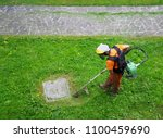 a gardener  with protective... | Shutterstock . vector #1100459690