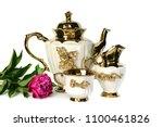 a white teapot with a golden... | Shutterstock . vector #1100461826