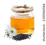 black cumin oil with flower | Shutterstock . vector #1100466566