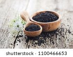 black cumin with flower on... | Shutterstock . vector #1100466653