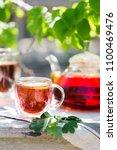 glass of black tea in double... | Shutterstock . vector #1100469476