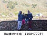 happy biracial family.... | Shutterstock . vector #1100477054
