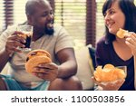 couple having fast food on the... | Shutterstock . vector #1100503856