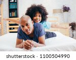 african american family of two  ... | Shutterstock . vector #1100504990