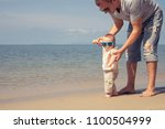 father and baby son playing on... | Shutterstock . vector #1100504999