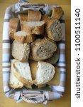 sliced bread in basket | Shutterstock . vector #1100511140