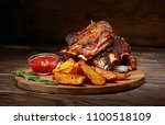 fried ribs with rosemary ... | Shutterstock . vector #1100518109