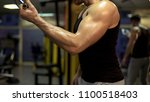 bodybuilder working out in... | Shutterstock . vector #1100518403