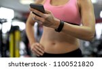 girl tracking weight loss and... | Shutterstock . vector #1100521820
