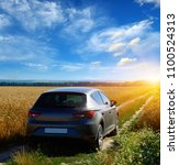 car on a dirt road in a field... | Shutterstock . vector #1100524313