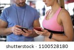 sporty woman synchronizing... | Shutterstock . vector #1100528180