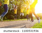 team fitness by jumping in the... | Shutterstock . vector #1100531936