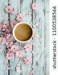 coffee and pink cherry blossoms ... | Shutterstock . vector #1100538566