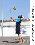 Small photo of OSTIA, ITALY. May 12, 2015: Man serve the ball during a beachvolley match between friends on the sand at the sea in Ostia, a town near Rome in Italy. Summer sports and recreation activity.