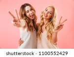 two happy pretty pretty women... | Shutterstock . vector #1100552429
