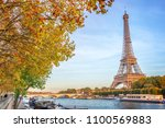 eiffel tower and the river... | Shutterstock . vector #1100569883