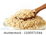 brown rice on white background  ... | Shutterstock . vector #1100571566