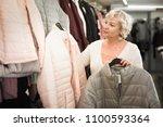 mature positive blonde woman... | Shutterstock . vector #1100593364