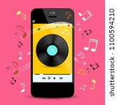 music player on smartphone with ... | Shutterstock .eps vector #1100594210