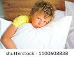 portrait of an awaked boy in... | Shutterstock . vector #1100608838