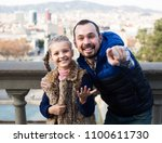 happy family looking at sight... | Shutterstock . vector #1100611730