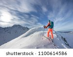 a skier walks in the mountains | Shutterstock . vector #1100614586