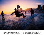 sunset silhouettes playing... | Shutterstock . vector #1100619320