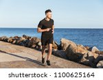 portrait of a strong sportsman... | Shutterstock . vector #1100625164