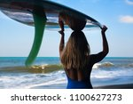 girl in bikini with surfboard... | Shutterstock . vector #1100627273